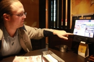 Lawler uses his college Japanese to read the menu...successfully..