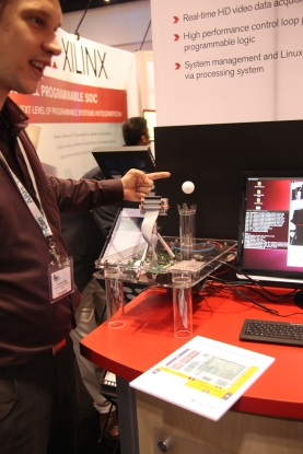 Xilinx showing off their FPGAs pretending to be ARM cores and running adaptive vision. The ball height follows your finger using computer vision.